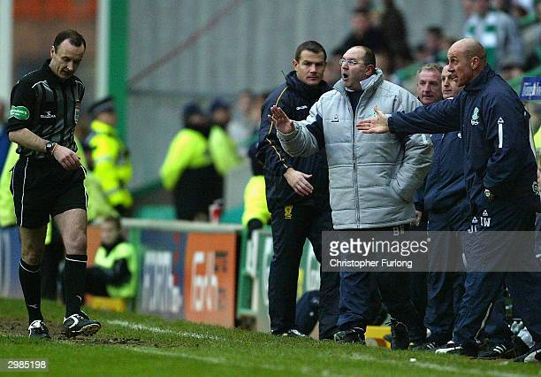 Hibernian manager Bobby Williamson and his assistant Andy Watson exchanges words with referee Mike McCurry during the Scottish premier league game...