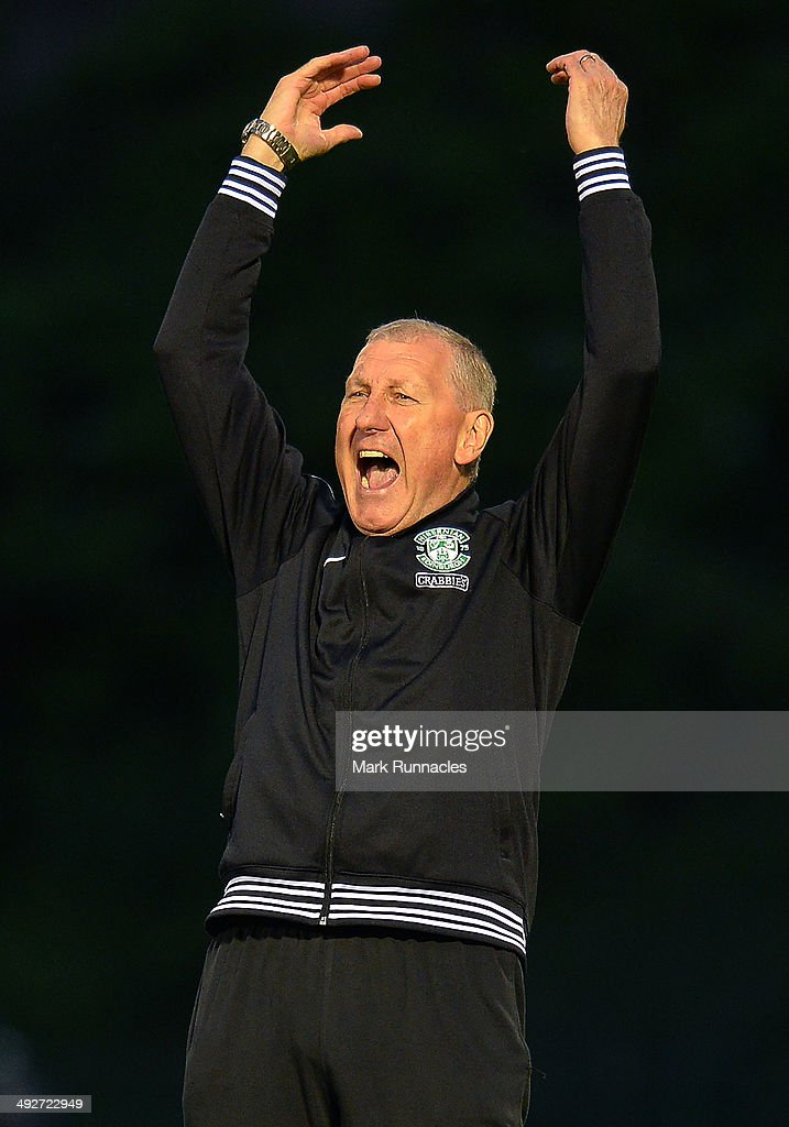 Hibernian manager Terry Butcher celebrates after his team beat Hamilton Academical 2-0 during the Scottish Premiership Play-off Final First Leg, between Hamilton Academical and Hibernian at New Douglas Park on May 21, 2014 in Hamilton Scotland.