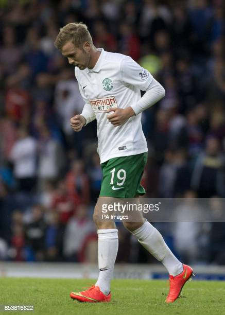 Hibernian's Danny Handling heads for the tunnel after he was shown a red card by referee John Beaton during the Petrofac Training Cup match at Ibrox...