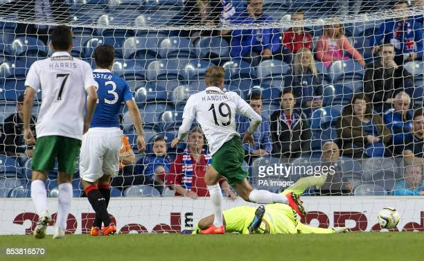 Hibernian's Danny Handling scores during the Petrofac Training Cup match at Ibrox Glasgow