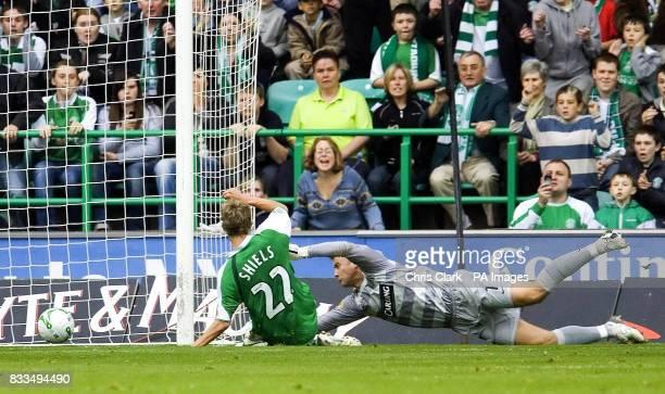 Hibernian's Dean Shiels scores after Celtic goalkeeper Artur Boruc dropped the ball during the Clydesdale Bank Scottish Premier League match at...