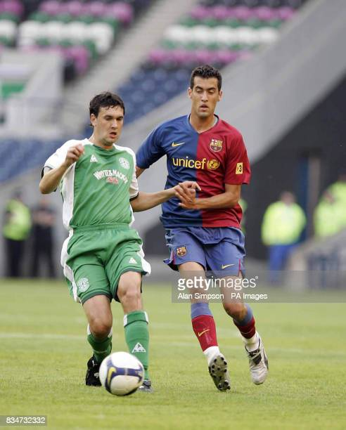 Hibernian's Ian Murray and Barcelona's Sergi Busquets battle for the ball during the PreSeason Friendly at Murrayfield Stadium Edinburgh