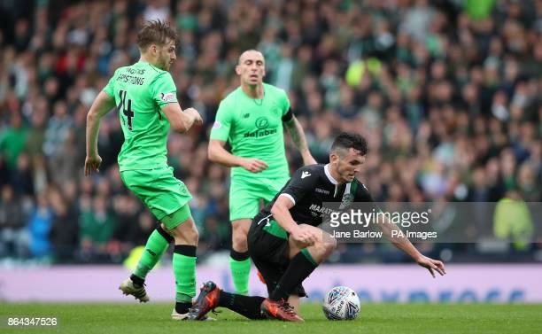 Hibernian's John McGinn is tackled by Celtic's Stuart Armstrong during the Betfred Cup semifinal match at Hampden Park Glasgow