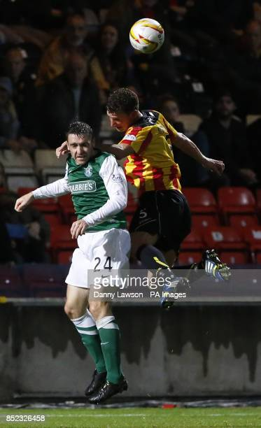 Hibernian's Paul Heffernan and Partick's Thistle's Aaron Muirhead battle for the ball during the Scottish Premiership match at Firhill Stadium Glasgow