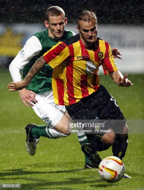 Hibernian's Scott Robertson and Partick's Thistle's Kallum Higginbotham battle for the ball during the Scottish Premiership match at Firhill Stadium...