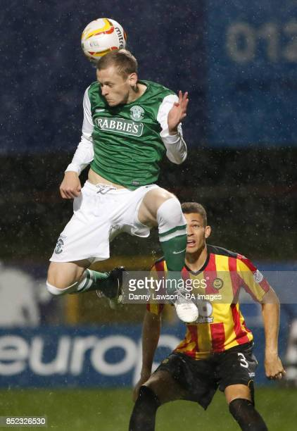 Hibernian's Scott Robertson beats Partick's Thistle's Aaron TaylorSinclair to the ball during the Scottish Premiership match at Firhill Stadium...