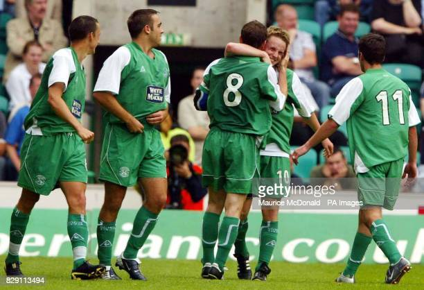 Hibernian's Tom McManus celebrates with teammates after scoring the opening goal against Leeds United during their preseason friendly match at Easter...