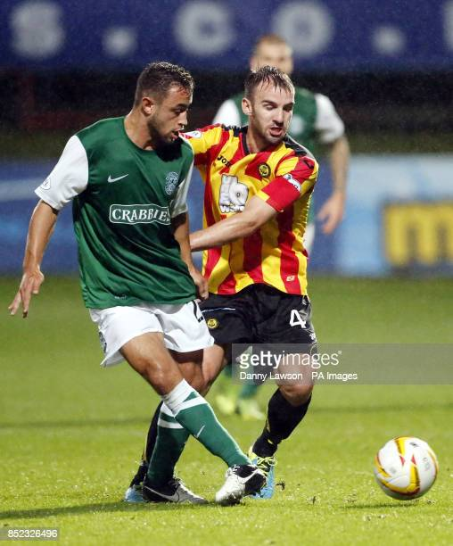 Hibernian's Tom Taiwo and Partick's Thistle's Sean Welsh battle for the ball during the Scottish Premiership match at Firhill Stadium Glasgow