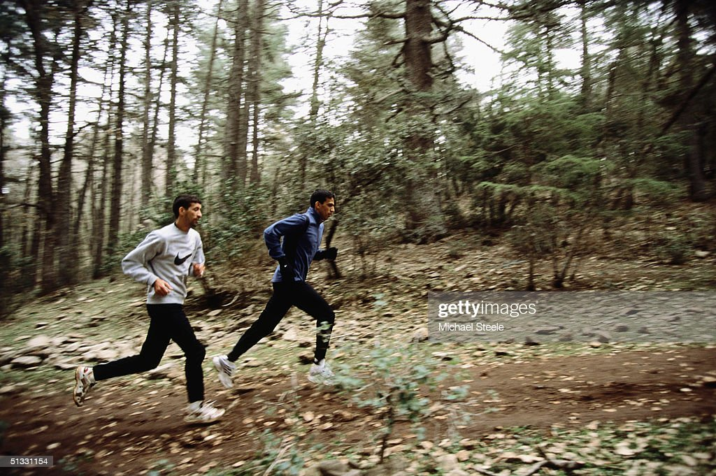 Hicham El Guerrouj of Morocco and a training partner in action during an early morning training run at the training centre in Ifrane, Morrocco on January 15 2002. Photo by Michael Steele / Getty Images