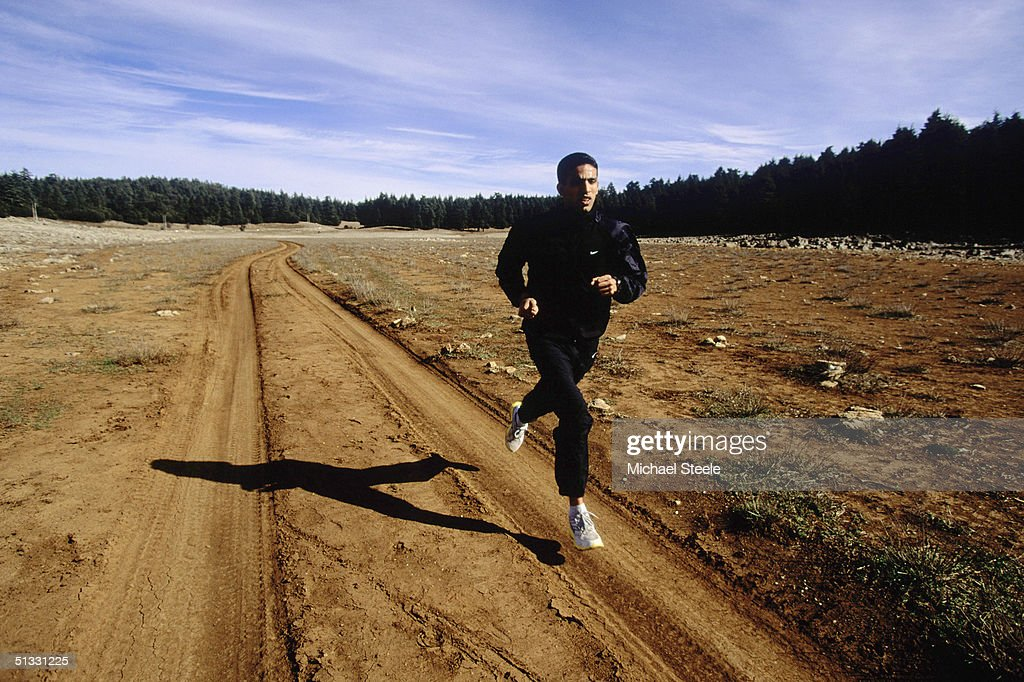 Hicham El Guerrouj of Morocco in full stride during an early morning training run at the training centre in Ifrane, Morrocco on January 15 2002. Photo by Michael Steele / Getty Images