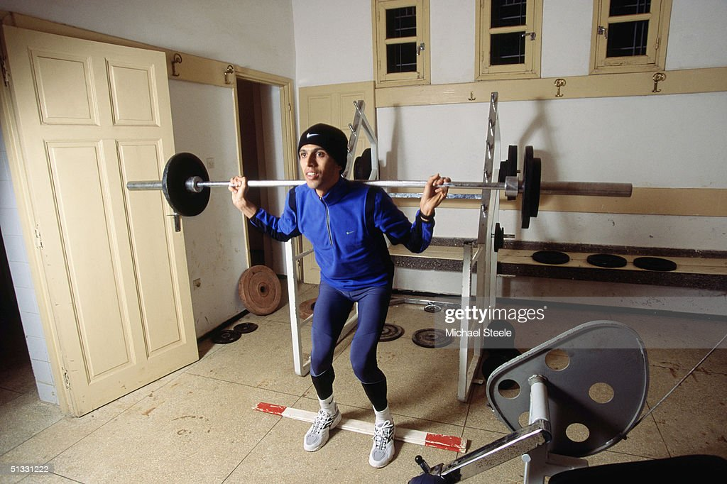 Hicham El Guerrouj of Morocco lifts a barbel during a weight training session at the training centre in Ifrane, Morrocco on January 15 2002. Photo by Michael Steele / Getty Images