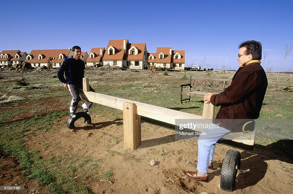 Hicham El Guerrouj of Morocco relaxes on a see-saw at the training centre in Ifrane, Morrocco on January 15 2002. Photo by Michael Steele / Getty Images