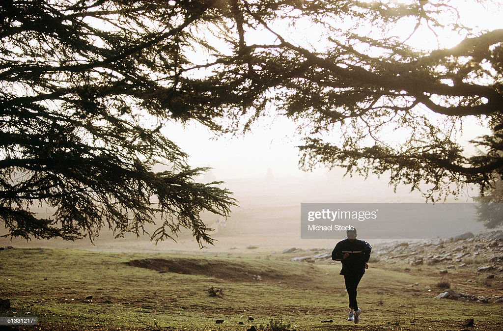 Hicham El Guerrouj of Morocco runs alone during an early morning training run at the training centre in Ifrane, Morrocco on January 15 2002. Photo by Michael Steele / Getty Images