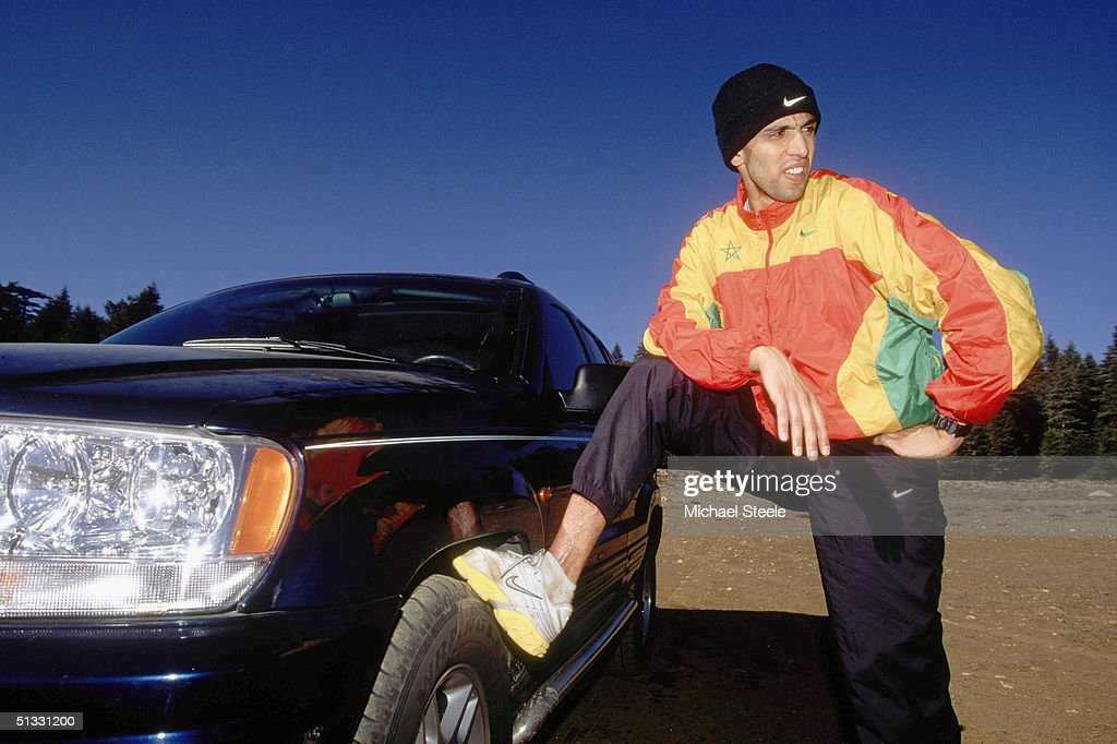 Hicham El Guerrouj of Morocco stretches before a training run at the training centre in Ifrane, Morrocco on January 15 2002. Photo by Michael Steele / Getty Images