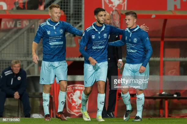 Hicham Faik of Excelsior celebrates 11 with Mike van Duinen of Excelsior and Jinty Caenepeel of Excelsior during the Dutch Eredivisie match between...