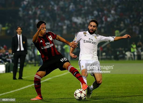 Hicham Mastour of AC Milan vies for the ball against Daniel Carvajal of Real Madrid during their world club friendly football match at the Sevens...