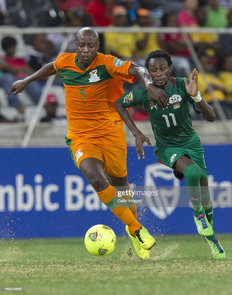 AFRICA - JANUARY 29, Hichani Himonde from Zambia (L) and B Y Jonathan Pitroipa from Burkina Faso in action during the 2013 Orange African Cup of Nations match between Burkina Faso and Zambia from Mbombela Stadium on January 29, 2013 in Nelspruit, South Africa.