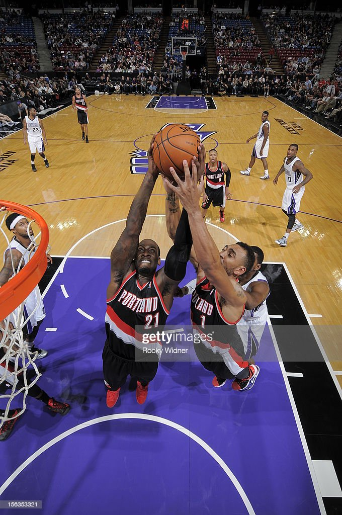 JJ Hickson #21 and Jared Jeffries #1 of the Portland Trail Blazers grab the rebound against the Sacramento Kings on November 13, 2012 at Sleep Train Arena in Sacramento, California.