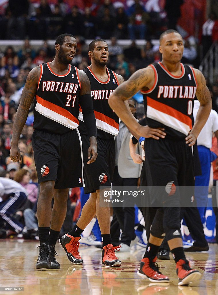 J.J. Hickson #21, LaMarcus Aldridge #12 and Damian Lillard #0 of the Portland Trail Blazers leave the court after a timeout trailing the Los Angeles Clippers at Staples Center on January 27, 2013 in Los Angeles, California. The Clippers won 96-83.