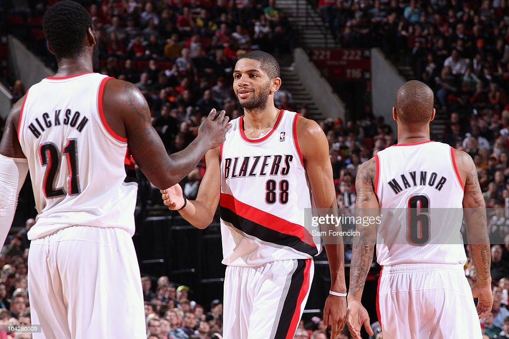 J.J. Hickson #21. Nicolas Batum #88 and Eric Maynor #6 of the Portland Trail Blazers walk on the court during the game against the Minnesota Timberwolves on March 2, 2013 at the Rose Garden Arena in Portland, Oregon.