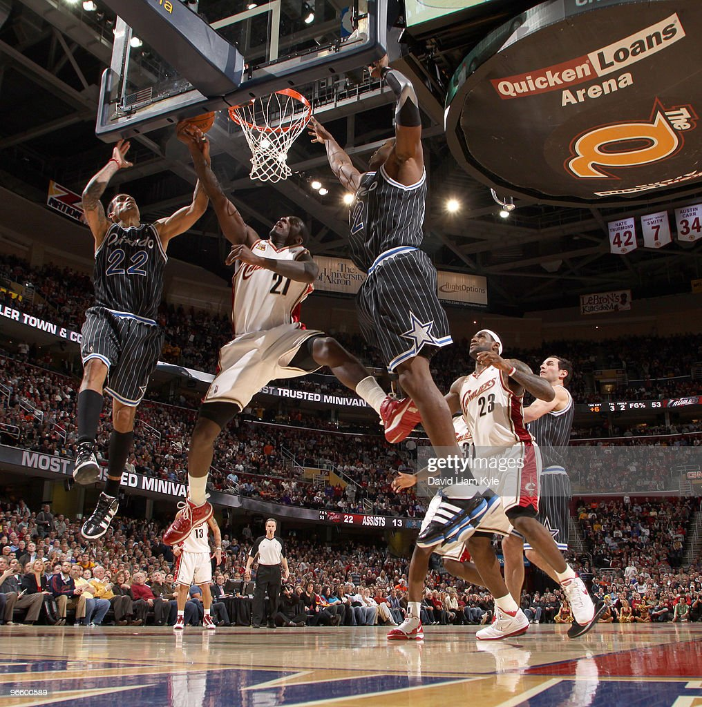 J Hickson of the Cleveland Cavaliers goes up for the shot against Matt Barnes and Dwight Howard of the Orlando Magic on February 11 2010 at The...