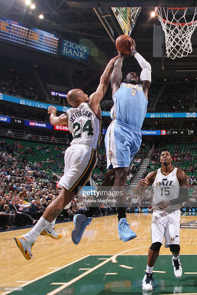 Hickson #7 of the Denver Nuggets drives to the basket against Richard Jefferson #24 of the Utah Jazz at EnergySolutions Arena on January 13, 2014 in Salt Lake City, Utah.