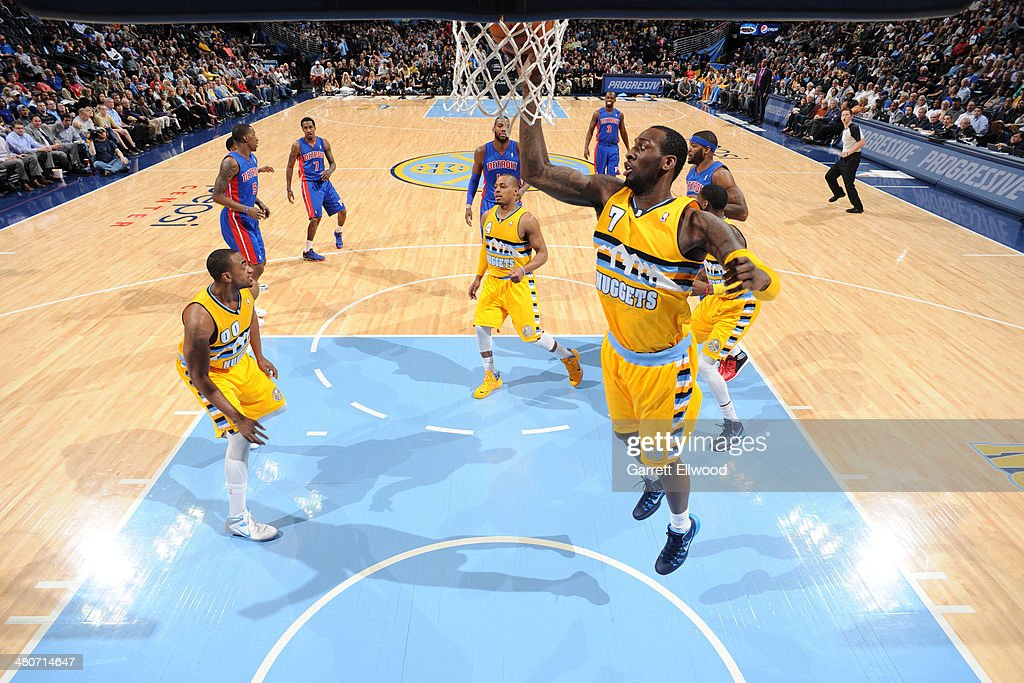 J.J. Hickson #7 of the Denver Nuggets grabs a rebound against the Detroit Pistons on March 19, 2014 at the Pepsi Center in Denver, Colorado.