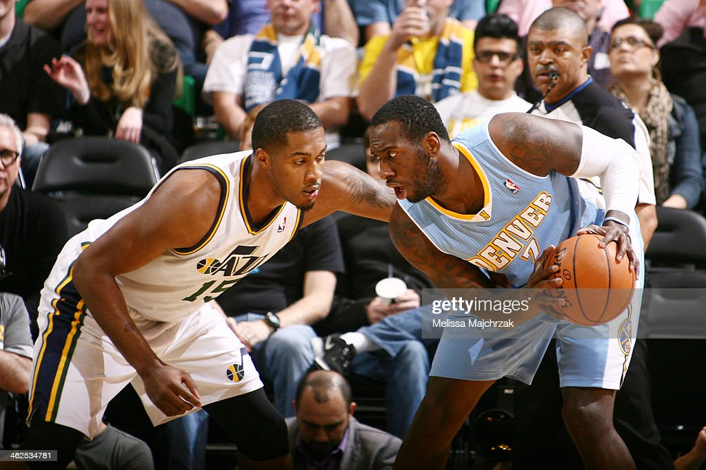 JJ Hickson #7 of the Denver Nuggets makes a move against Derrick Favors #15 of the Utah Jazz at EnergySolutions Arena on January 13, 2014 in Salt Lake City, Utah.