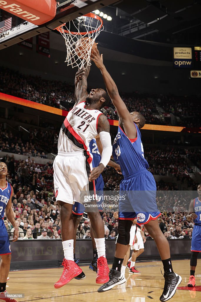 J.J. Hickson #21 of the Portland Trail Blazers battle for the ball control with Lavoy Allen #50 of the Philadelphia 76ers during the game between the Philadelphia 76ers and the Portland Trail Blazers on December 29, 2012 at the Rose Garden Arena in Portland, Oregon.
