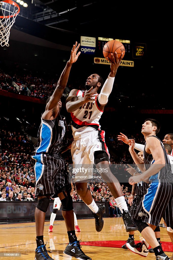 J.J. Hickson #21 of the Portland Trail Blazers drives to the basket against Andrew Nicholson #44 of the Orlando Magic on January 7, 2013 at the Rose Garden Arena in Portland, Oregon.