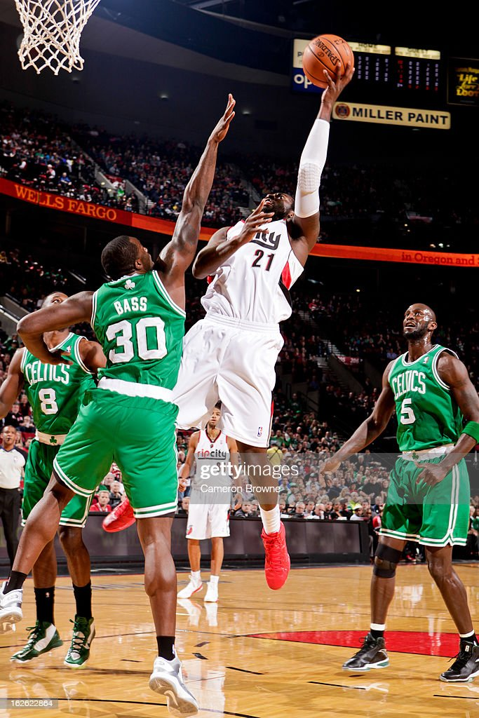 J.J. Hickson #21 of the Portland Trail Blazers drives to the basket against Brandon Bass #30 of the Boston Celtics on February 24, 2013 at the Rose Garden Arena in Portland, Oregon.