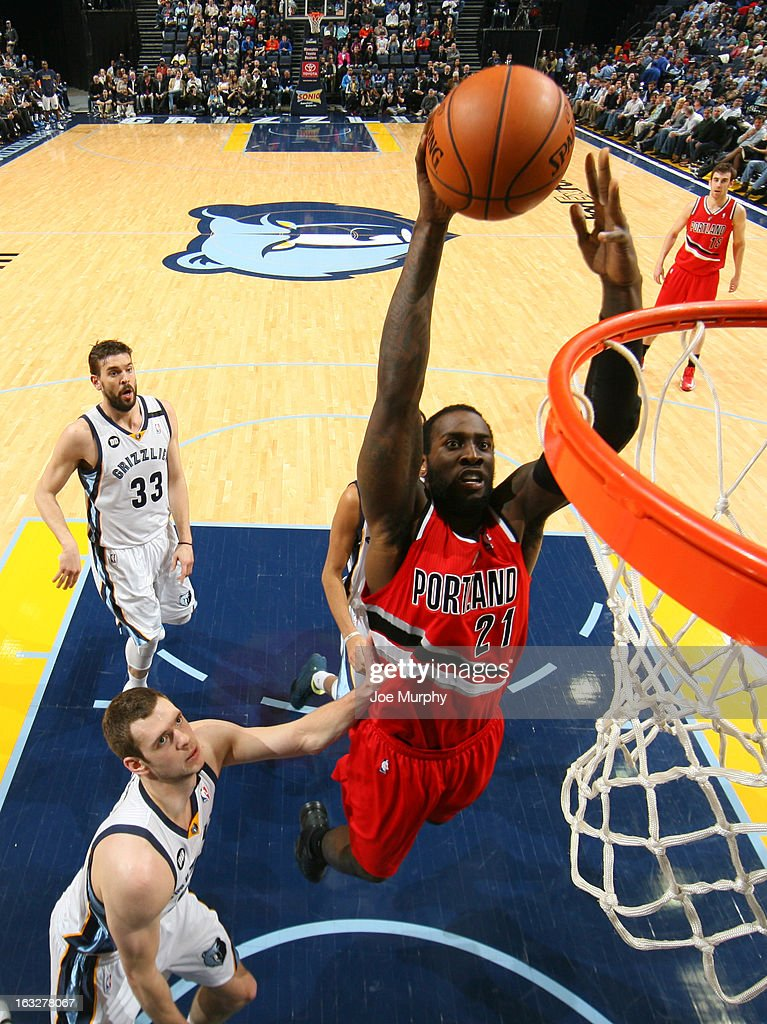 J.J. Hickson #21 of the Portland Trail Blazers dunks against Jon Leuer #30 of the Memphis Grizzlies on March 6, 2013 at FedExForum in Memphis, Tennessee.