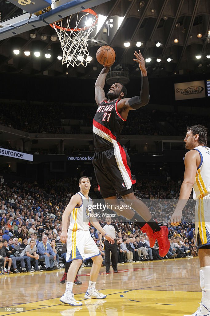 J.J. Hickson #21 of the Portland Trail Blazers dunks against the Golden State Warriors on March 30, 2013 at Oracle Arena in Oakland, California.