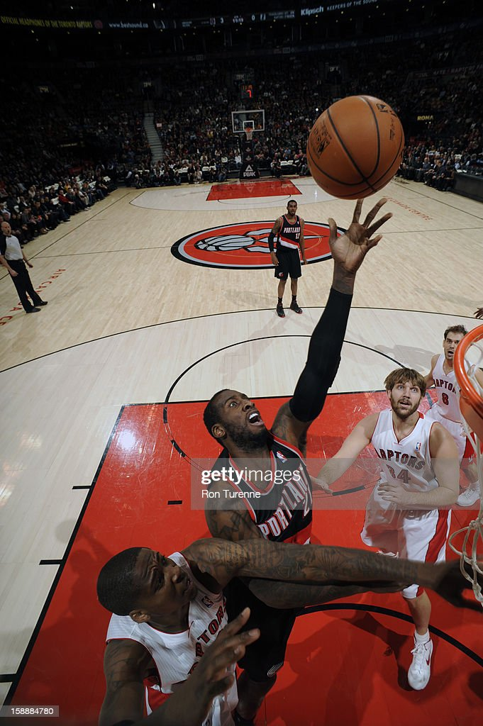 J.J. Hickson #21 of the Portland Trail Blazers goes in for the easy layup against the Toronto Raptors during the game on January 2, 2013 at the Air Canada Centre in Toronto, Ontario, Canada.