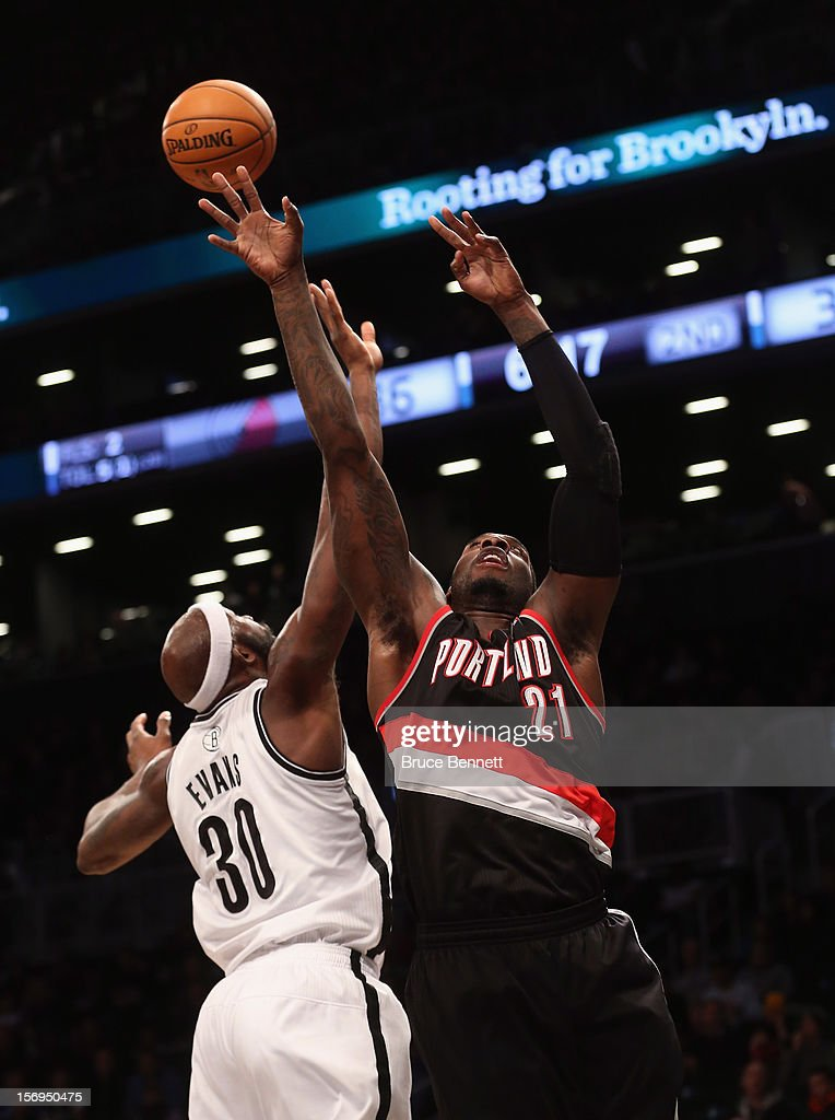 J.J. Hickson #21 of the Portland Trail Blazers goes up against Reggie Evans #30 of the Brooklyn Nets at the Barclays Center on November 25, 2012 in the Brooklyn borough of New York City.