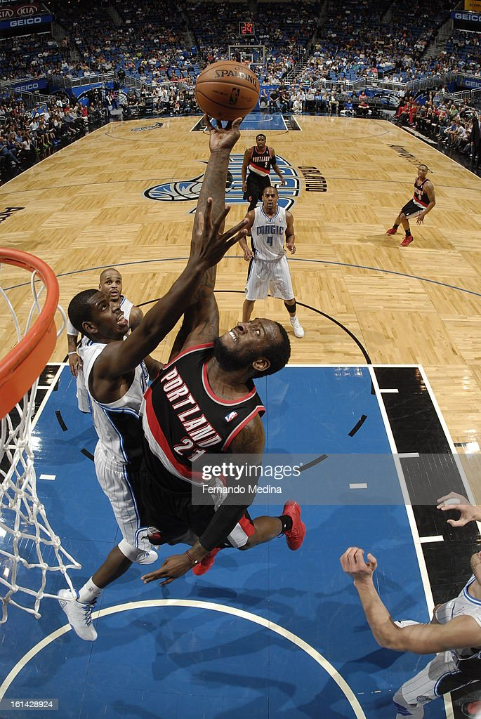 J.J. Hickson #21 of the Portland Trail Blazers goes up for a rebound against Andrew Nicholson #44 of the Orlando Magic on February 10, 2013 at Amway Center in Orlando, Florida.