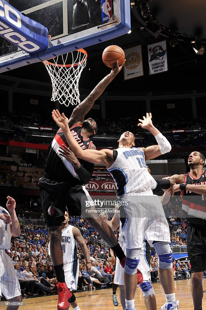 J.J. Hickson #21 of the Portland Trail Blazers goes up for a rebound against Gustavo Ayon #19 of the Orlando Magic on February 10, 2013 at Amway Center in Orlando, Florida.