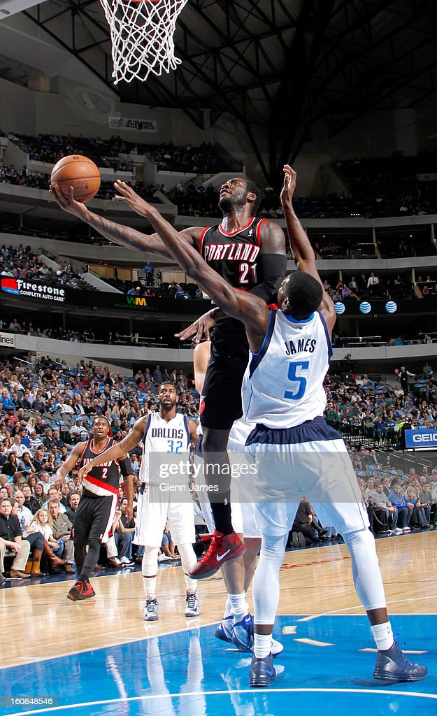 J.J. Hickson #21 of the Portland Trail Blazers lays the ball up against Bernard James #5 of the Dallas Mavericks on February 6, 2013 at the American Airlines Center in Dallas, Texas.