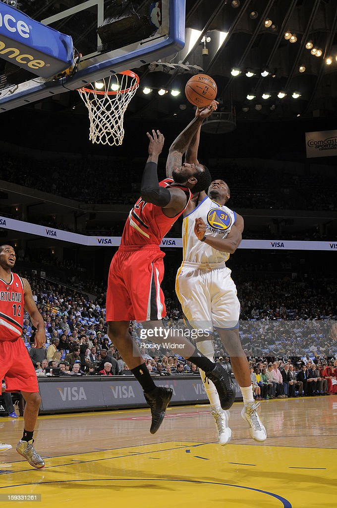 J.J. Hickson #21 of the Portland Trail Blazers rebounds against Festus Ezeli #31 of the Golden State Warriors on January 11, 2013 at Oracle Arena in Oakland, California.