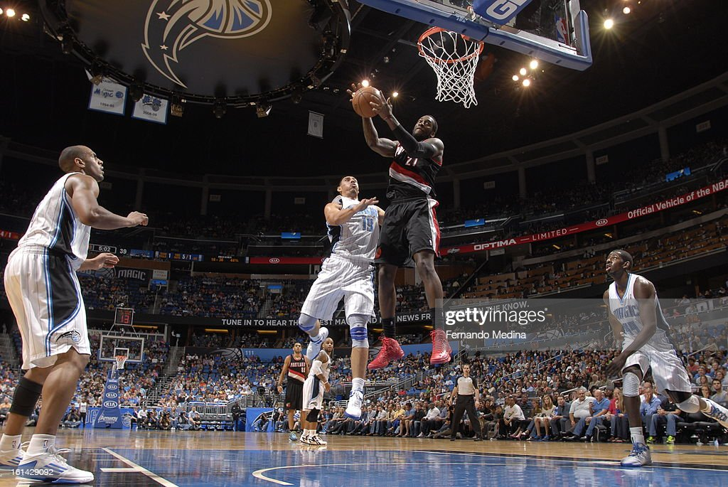 J.J. Hickson #21 of the Portland Trail Blazers rebounds against Gustavo Ayon #19 of the Orlando Magic on February 10, 2013 at Amway Center in Orlando, Florida.