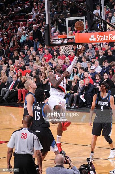 J Hickson of the Portland Trail Blazers shoots a layup against Mickael Gelabale Greg Stiemsma and Ricky Rubio of the Minnesota Timberwolves on March...