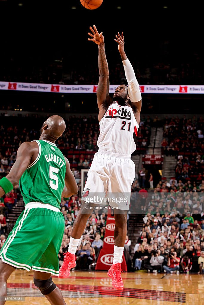 J.J. Hickson #21 of the Portland Trail Blazers shoots against Kevin Garnett #5 of the Boston Celtics on February 24, 2013 at the Rose Garden Arena in Portland, Oregon.