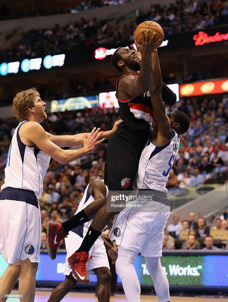 J.J. Hickson #21 of the Portland Trail Blazers takes a shot against Bernard James #5 of the Dallas Mavericks at American Airlines Center on February 6, 2013 in Dallas, Texas.