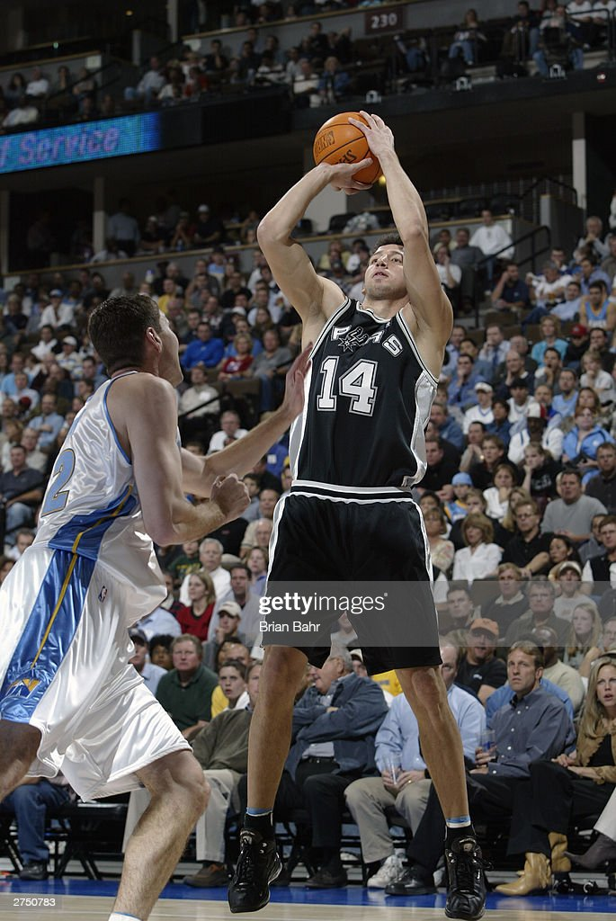 Hidayet Turkoglu #14 of the San Antonio Spurs shoots a jump shot during the game against of the Denver Nuggets on October 29, 2003 at the Pepsi Center in Denver, Colorado. The Nuggets won 80-72.
