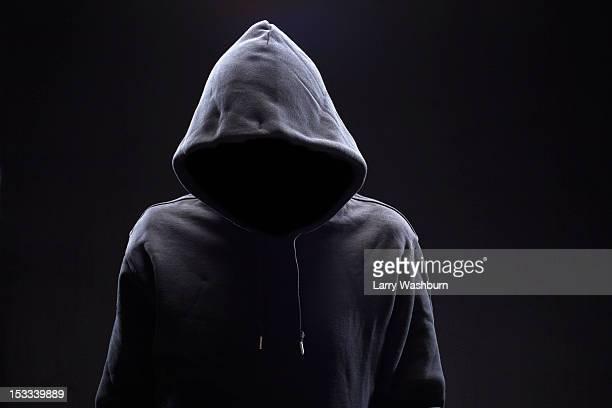 Hidden man in hooded top