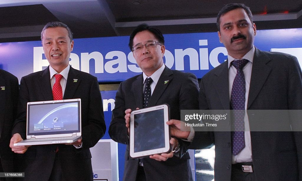 Hide Harada director of products Business Unit (C) and Toru Hasegawa Managing Director-System Sales Division Panasonic india (R) with Gunjan Sachdev General Manager Panasonic India (L) during a Launched of world's first ruggedized tablet Toughpad FZ-A1 and Panasonic CF-AX2 on December 5, 2012 in New Delhi, India.