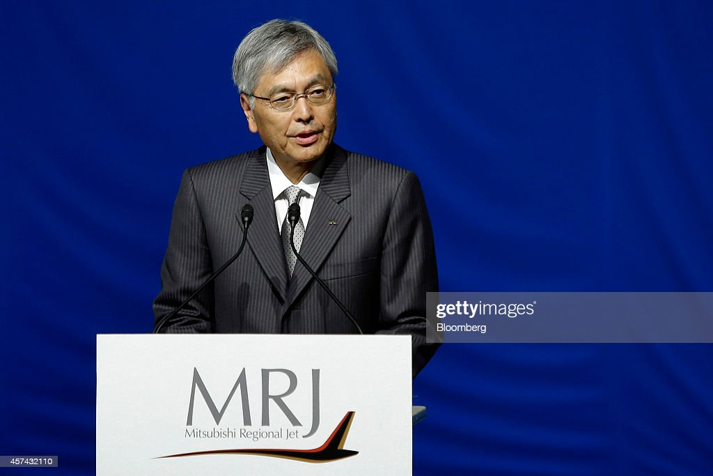 <a gi-track='captionPersonalityLinkClicked' href=/galleries/search?phrase=Hideaki+Omiya&family=editorial&specificpeople=5398116 ng-click='$event.stopPropagation()'>Hideaki Omiya</a>, chairman of Mitsubishi Heavy Industries Ltd., speaks during a rollout ceremony for the Mitsubishi Regional Jet (MRJ) passenger aircraft, developed by Mitsubishi Aircraft Corp., at Mitsubishi Heavy Industries Ltd.'s Nagoya Aerospace Systems Works Komaki South Plant in Toyoyama, Aichi Prefecture, Japan, on Saturday, Oct. 18, 2014. Japan unveiled its first passenger jet today after a delay of almost four years, with a helping hand from bullet-train specialists as it prepares for test flights next year. Photographer: Kiyoshi Ota/Bloomberg via Getty Images
