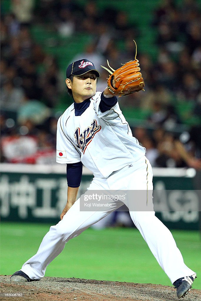 <a gi-track='captionPersonalityLinkClicked' href=/galleries/search?phrase=Hideaki+Wakui&family=editorial&specificpeople=5491133 ng-click='$event.stopPropagation()'>Hideaki Wakui</a> #11 of Japan pitches during the World Baseball Classic First Round Group A game between Japan and China at Fukuoka Yahoo! Japan Dome on March 3, 2013 in Fukuoka, Japan.