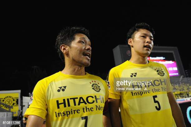 Hidekazu Otani and Yuta Nakayama of Kashiwa Reysol leave the pitch after their 12 defeat in the JLeague J1 match between Cerezo Osaka and Kashiwa...