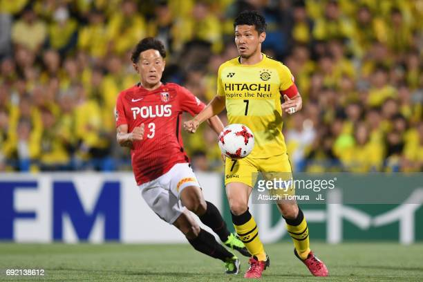 Hidekazu Otani of Kashiwa Reysol and Tomoya Ugajin of Urawa Red Diamonds compete for the ball during the JLeague J1 match between Kashiwa Reysol and...